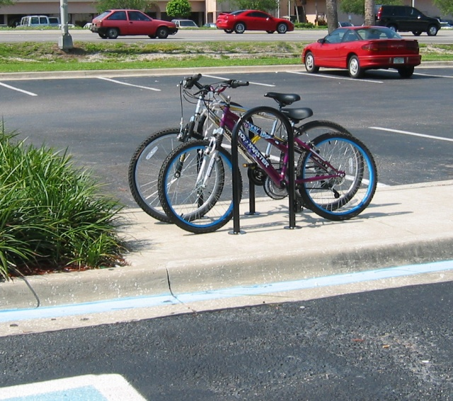"""Inverted U"" bike racks provide two points-of-support for each bike, support locking the bike securely, AND hold 2 bikes per ""U"", one on each side. Multi ""U"" strips are available where only 4 attachment points to the pavement are used, just like the current Hardee's bike rack."