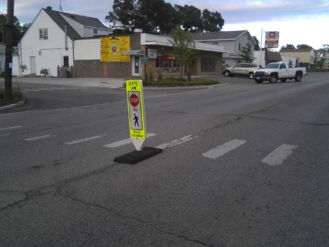 An enhanced marked crosswalk in downtown Round Lake Heights, helping to make sure that everyone knows a full stop is required when the crosswalk is in use.